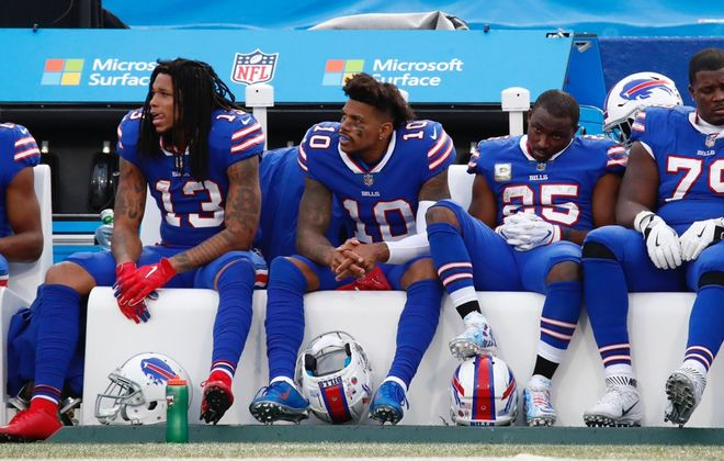 Bills offensive players look on from the bench during the fourth quarter against the Bears. (Harry Scull Jr./Buffalo News)
