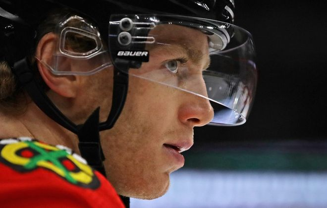 Patrick Kane of the Chicago Blackhawks eyes an opponent before a faceoff against the Minnesota Wild at the United Center on December 17, 2017 in Chicago, Ill. (Photo by Jonathan Daniel/Getty Images)