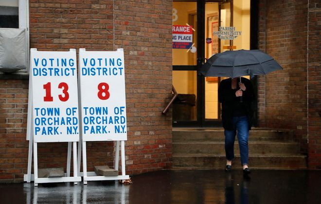 Voters take to the polls in the rain at St. Bernadette church in Orchard Park. (Mark Mulville/Buffalo News)