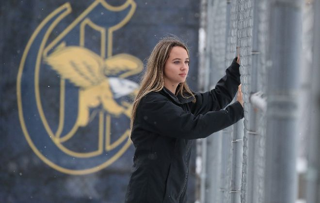 Emily Scheck's roommates  raised money for her after her family cut her off. The NCAA now says she can keep the money and retain her athletic eligibility. She's shown here at the Koessler Athletic Center. (James P. McCoy/Buffalo News)