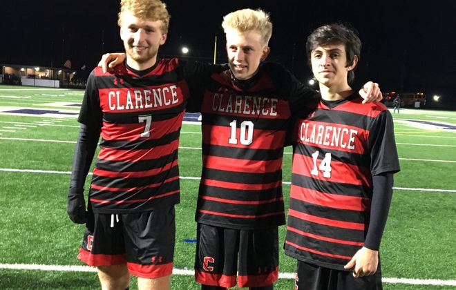 Clarence soccer players, from left, Quinn Neelon, Nathan Vesper and Aiden Steck are going to states 34 years after their fathers led the Red Devils there for the first time. (Contributed photo)
