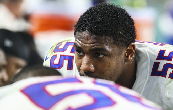 Jerry Hughes began his NFL career 10 years ago, healthy but inactive for the Indianapolis Colts' season opener in Houston, his hometown. On Saturday, he'll return to help lead the Buffalo Bills' defense in a wild card game against the Houston Texans. (James P. McCoy/News file photo)