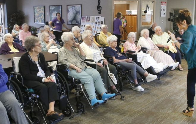 A visiting entertainer performs for residents at the Elderwood at Lancaster facility on Como Park Boulevard in Lancaster. (Robert Kirkham/Buffalo News)
