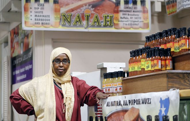 Bisharo Ali, from Somalia, at her stand at the Broadway Market. (Mark Mulville/Buffalo News)