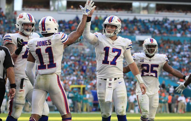 Bills quarterback Josh Allen congratulates Zay Jones on his two-point conversion during the fourth quarter last week. (Harry Scull Jr./Buffalo News)