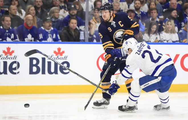 Buffalo Sabres center Jack EIchel knocks the stick out of the hand of Toronto Maple Leafs Nikita Zaitsev during first period action at the KeyBank Center on Tuesday, Dec. 4, 2018. (Harry Scull Jr./ Buffalo News)