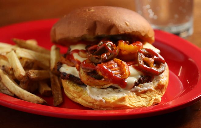 Stack Burger's award-winning Demon Burger, which inspired the mac and cheese, is a quarter-pound burger topped with Demon spices, jalapeños, banana peppers, cheese and garlic Parmesan spread. (Sharon Cantillon/News file photo)