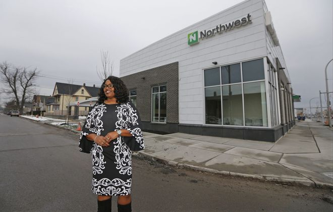 Trina Burruss of Northwest Bank, shown outside the new Jefferson Avenue branch. (Robert Kirkham/Buffalo News)