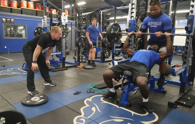 Lewis Caralla, left, leaves the UB football program after less than a year as its strength and conditioning coach. (John Hickey/News file photo)