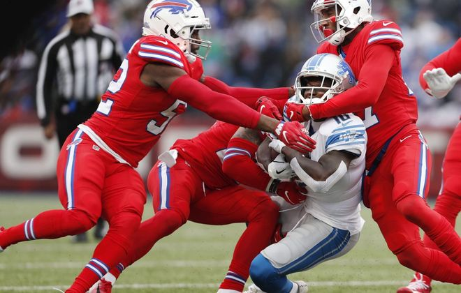 Bills defenders swarm Lions receiver Brandon Powell during Sunday's win at New Era Field. (Mark Mulville/Buffalo News)
