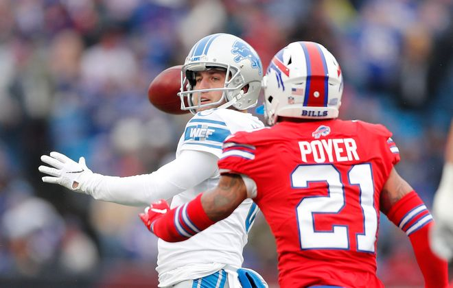 Bills' Jordan Poyer pressures Lions' Sam Martin on a botched extra point in the second quarter at New Era Field on Sunday, Dec. 16, 2018.(Mark Mulville/Buffalo News)