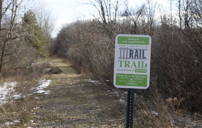 This former rail bed off of Jewett Holmwood Road in Orchard Park is planned for a Rails to Trails conversion. (Derek Gee/Buffalo News)