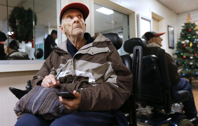 John Flickner, 78, waits for word on where he can go after being evicted from his Niagara Towers apartment for his use of medical marijuana. (Robert Kirkham/Buffalo News)