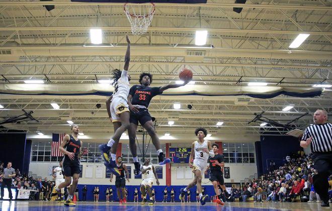 Park guard Keonjay Carter drives to the basket against Niagara Falls (Harry Scull Jr./ Buffalo News)