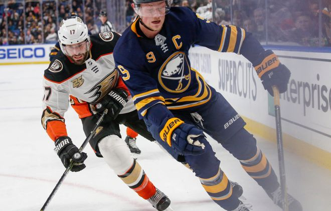 Jack Eichel chases the puck into the corner as he is pressured by Anaheim Ducks forward Ryan Kesler on Dec. 22. (Derek Gee/Buffalo News)