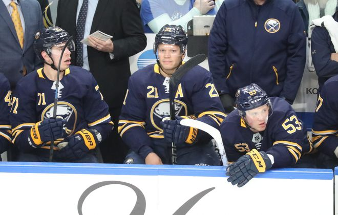 Buffalo Sabres right wing Kyle Okposo  sits on the bench waiting for his shift in the first period at the KeyBank Center on Saturday, Dec. 8, 2018.  (James P. McCoy/Buffalo News)