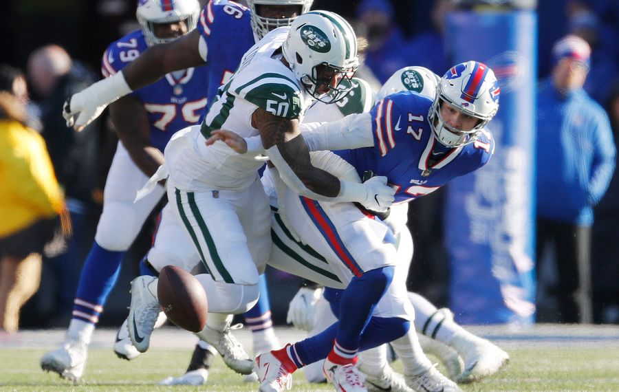 Josh Allen fumbles the ball while pressured by New York Jets Frankie Luvu and Kevin Pierre-Louis in the first quarter. (Mark Mulville/Buffalo News)