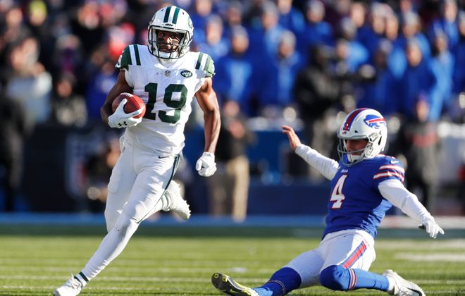 Bills' Stephen Hauschka can't stop Jets' Andre Roberts on a return in the second quarter.(Mark Mulville/Buffalo News)