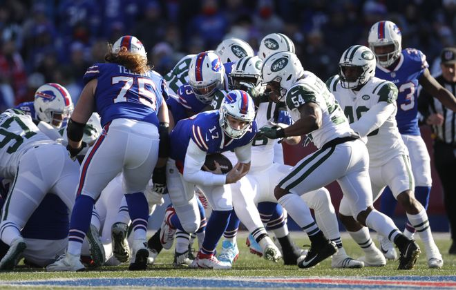 Buffalo Bills Josh Allen slips through the New York Jets defense on a 3rd down and short in the first quarter at New Era Field in Orchard Park Sunday, December 9, 2018. (Mark Mulville/Buffalo News)