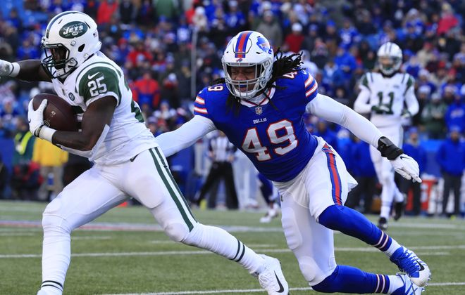 Bills linebacker Tremaine Edmunds attempts to tackle New York Jets running back Elijah McGuire. (Harry Scull Jr./ Buffalo News)