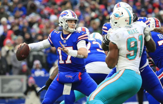 Bills quarterback Josh Allen threw three touchdown passes Sunday against the Dolphins. (Harry Scull Jr./Buffalo News)