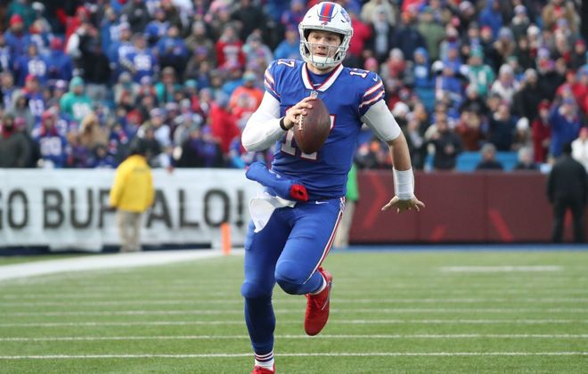 Bills quarterback Josh Allen rushes for a touchdown. (James P. McCoy/Buffalo News)