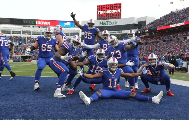 Bills wide receiver Robert Foster poses with his teammates after scoring a touchdown in the third quarter on Sunday, Dec. 30, 2018. (James P. McCoy/Buffalo News)