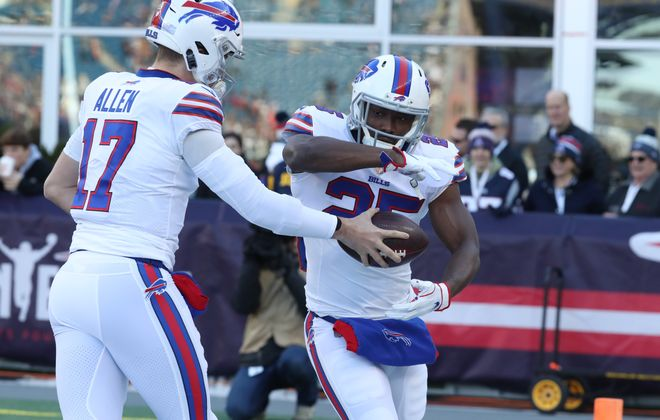 Bills running back LeSean McCoy takes a handoff during pregame warmups. (James P. McCoy/Buffalo News)