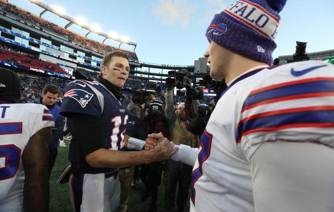 Bills quarterback Josh Allen and Patriots quarterback Tom Brady shake hands at the end of the game. (James P. McCoy/Buffalo News)