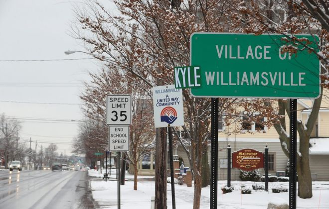 A sign altered marking Buffalo Bills Kyle Williams retirement from the Bills after todays game against Miami, on Main Street in Williamsville, N.Y., on Sunday, Dec. 30, 2018.   (John Hickey/Buffalo News)