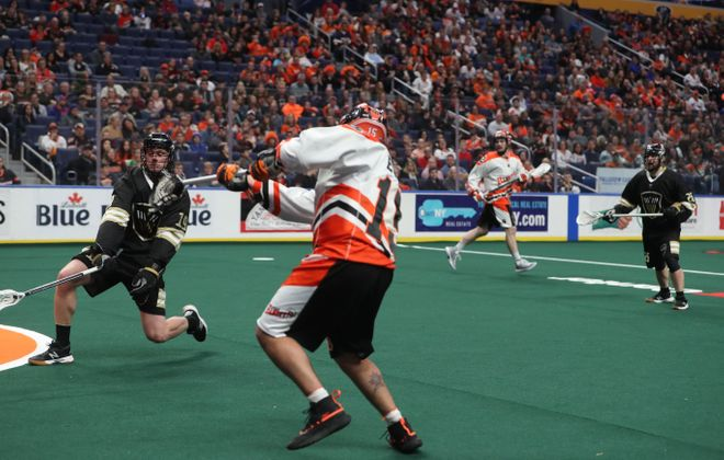 The Bandits' Shawn Evans (15) scores the Buffalo's' 14th goal against Vancouver as the Warriors' Justin Salt gets into position to try to defend late in the third quarter Friday night at KeyBank Center. The Bandits won, 16-10 (John Hickey/Buffalo News)