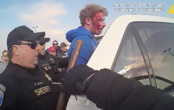 A still frame from an Erie County sheriff's deputy's  body camera shows Deputy Kenneth P. Achtyl, left, arresting Nicholas H. Belsito, right, for cursing at him during an incident outside New Era Field in December 2017. (Provided photo)