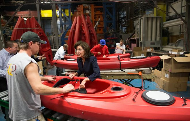 Lt. Gov. Kathy Hochul chats with workers at North Tonawanda's Confer Plastics, where owner Bob Confer says the hike in New York's minimum wage will force him to raise pay – and prices –  just so the maker of molded plastic products can compete for workers. (Derek Gee/News file photo)