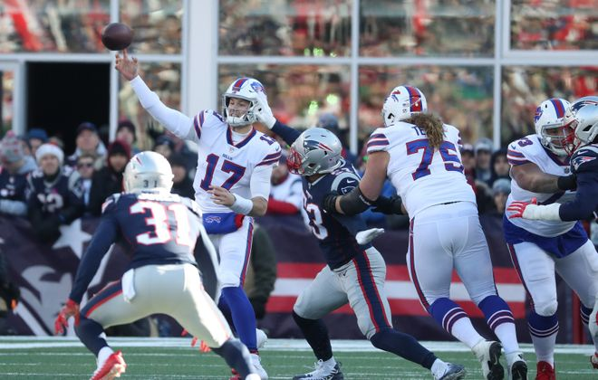 Josh Allen throws a pass in the first quarter of Sunday's loss to the Patriots. (James P. McCoy/Buffalo News)