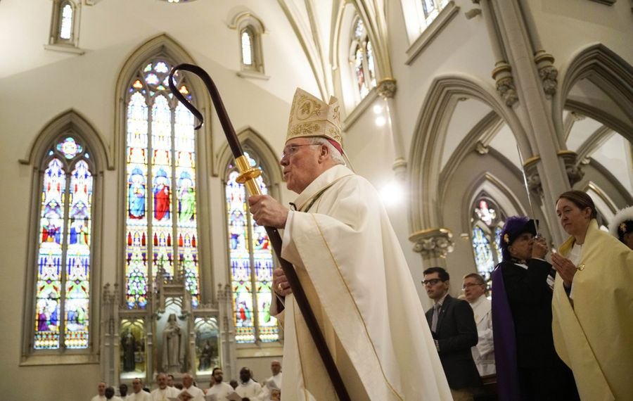 Buffalo Diocese Bishop Richard J. Malone walks down the aisle during an ordination of new priests at St. Joseph Cathedral in Buffalo in June. (Derek Gee/News file photo)