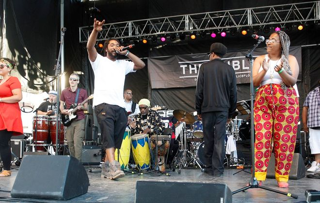 Buffalo Afrobeat Orchestra performs before Public Enemy who is headlining the Canalside Thursday concert series, Thursday, June 23, 2016.  (Sharon Cantillon/Buffalo News)
