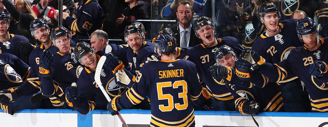 Jeff Skinner of the Buffalo Sabres celebrates his third-period goal at the bench during an NHL game against the Montreal Canadiens on Nov. 23, 2018 at KeyBank Center in Buffalo. (Photo by Bill Wippert/NHLI via Getty Images)
