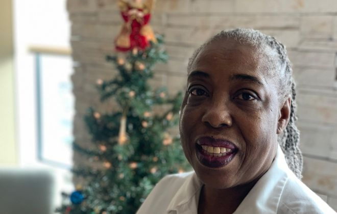Gloria Peay, a food service ambassador at Kenmore Mercy Hospital, often sings songs to greet new patients and bid goodbye to patients about to be released. She also throws in some Christmas carols for good measure this time of year. (Scott Scanlon/Buffalo News)