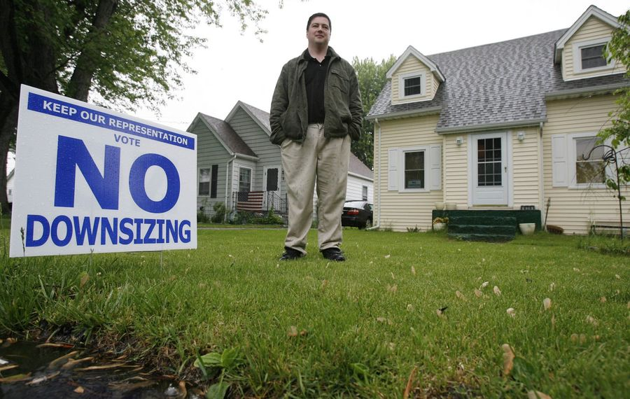 Dan Warren in front of his home when he was against downsizing in  2009.  (Mark Mulville/News file photo)