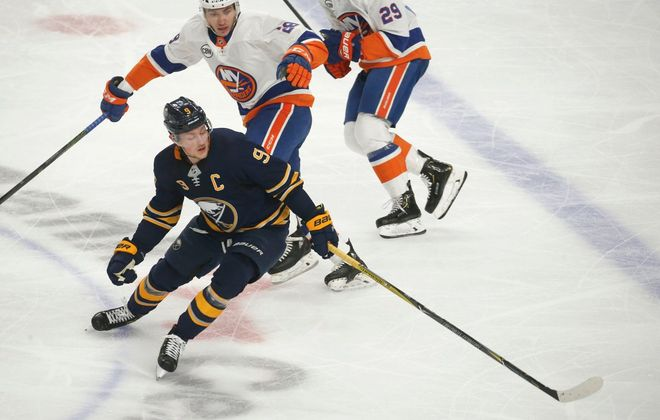 Jack Eichel tries to corral a loose puck in the neutral zone during the first period Monday night. (Robert Kirkham/The Buffalo News)