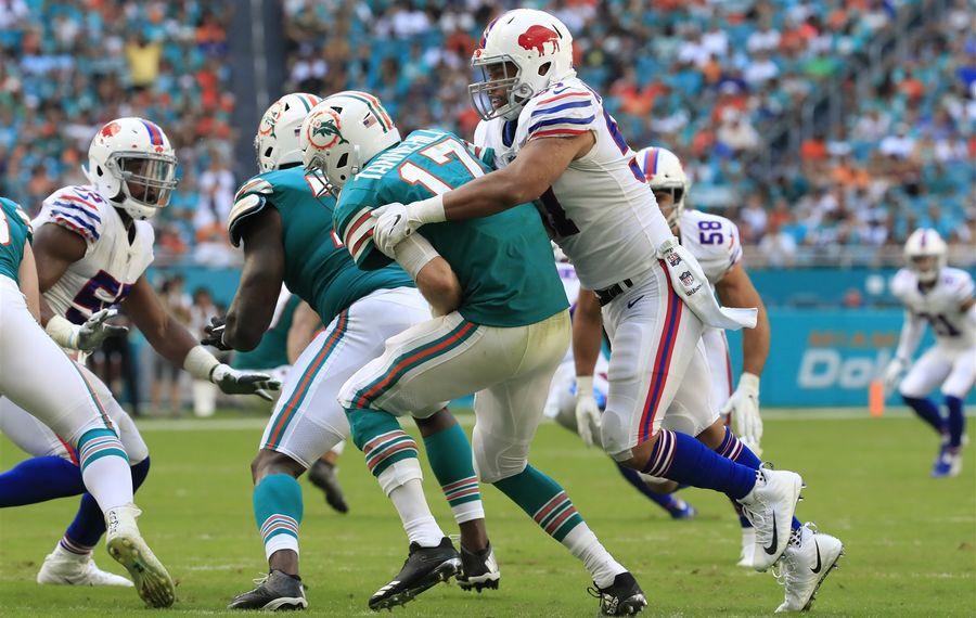 Bills linebacker Lorenzo Alexander sacks Ryan Tannehill during the second quarter. (Harry Scull Jr./Buffalo News)