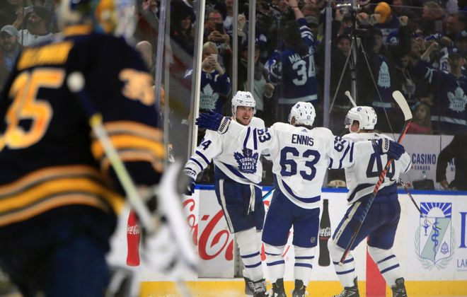 Auston Matthews celebrates his overtime winner with Leafs teammates Tyler Ennis and Morgan Rielly. (Harry Scull Jr./Buffalo News)