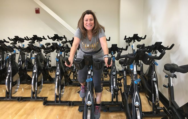 """Miranda Patterson works out five days a week at the Lockport Family YMCA. """"If you do yoga three, four times a week, you're golden. It heals, your mind, your body, everything."""" (Photo courtesy of Miranda Patterson)"""
