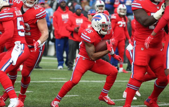 Bills running back Marcus Murphy (45) runs with the ball during warmups on Sunday, Dec. 16, 2018.  (James P. McCoy/Buffalo News)