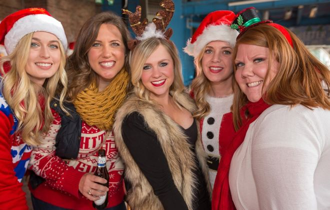 Smiling faces - in Santa costumes - at the 2017 SantaCon, which returns this Saturday. (Don Nieman/Special to The News)
