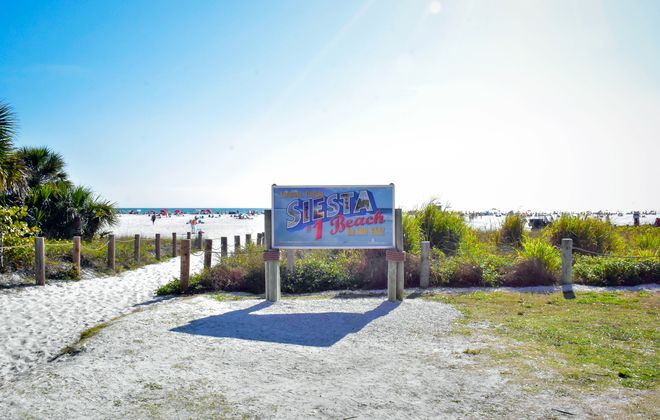 The famous Siesta Key sign welcomes visitors to the beach.