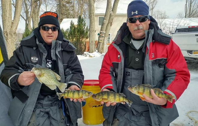 Pete Hendler of Bloomfield and Dave Pappiano of Avon show off some of their perch and crappie from last winter. (Submitted photo)