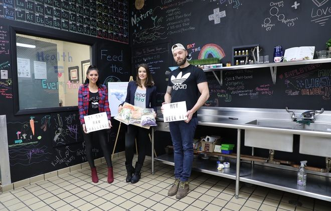 Brittany Kruse, left and Alex Miller, right, are planning to eat only raw food for the month of January. Sharon Cryan, center, founder of Food Nerd, will prepare the meals. The trio posed in Cryan's kitchen. (Photo courtesy of Brittany Kruse)