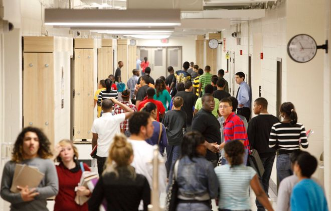 Students congregate in one of the main corridors of McKinley High School. (Derek Gee/News file photo
