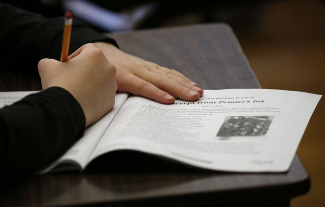 Fifth grade students at Benjamin Franklin Middle School take the state test, Thursday, April 12, 2018.  (Derek Gee/Buffalo News)